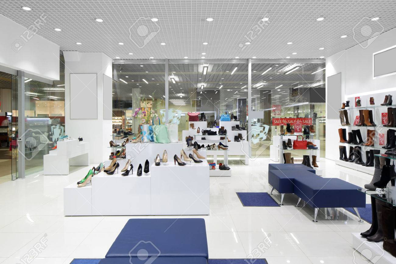 bright and fashionable interior of shoe store in modern mall - 35288678