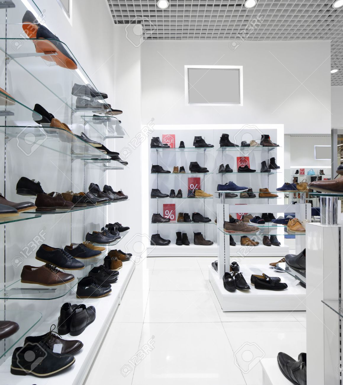 bright and fashionable interior of shoe store in modern mall - 35288680