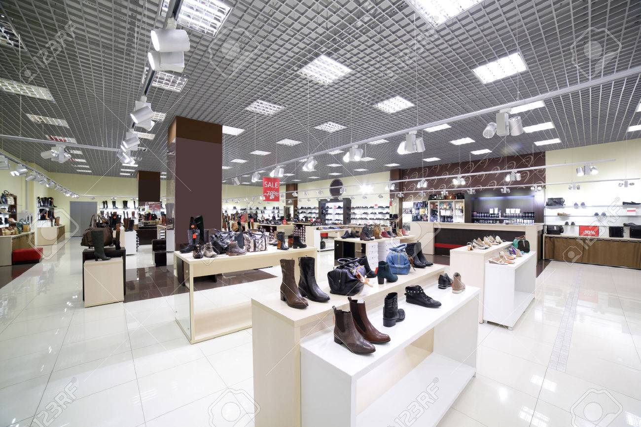 bright and fashionable interior of shoe store in modern mall - 34298874