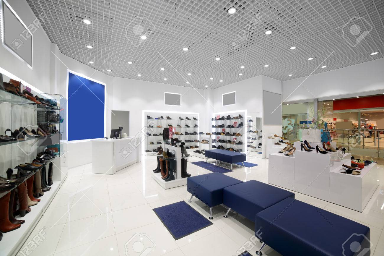 bright and fashionable interior of shoe store in modern mall - 34076188