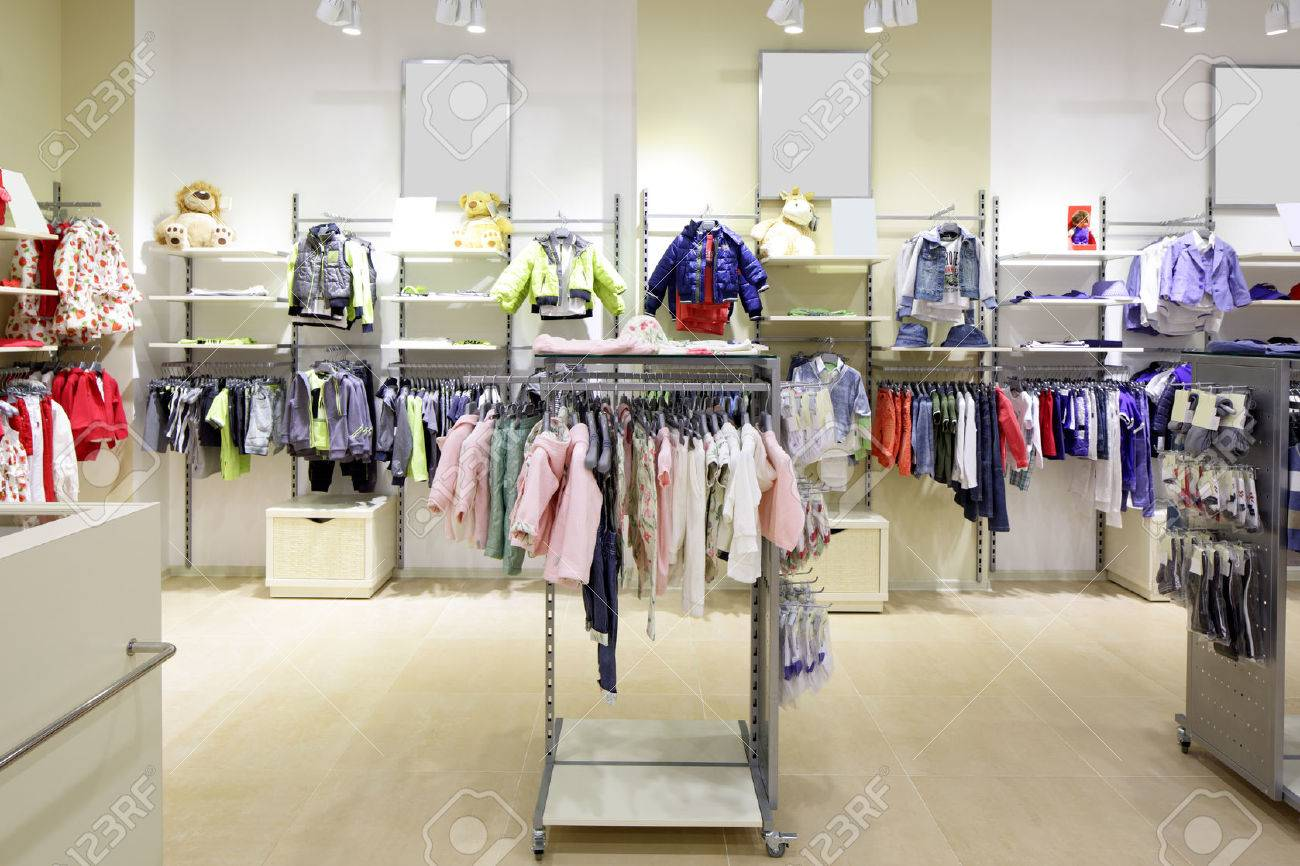 luxury and fashionable brand new interior of kids cloth store - 34076233