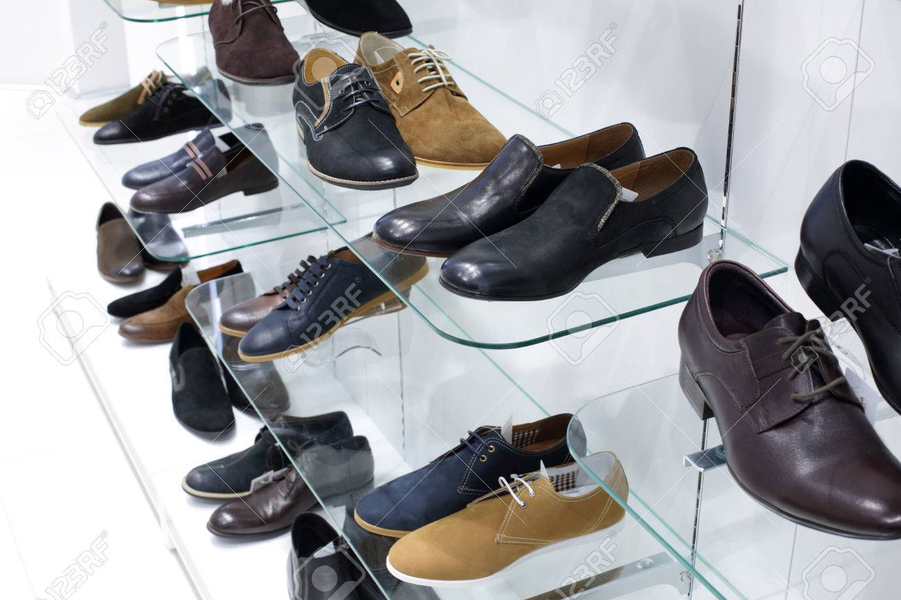 bright and fashionable interior of shoe store in modern mall - 34076618