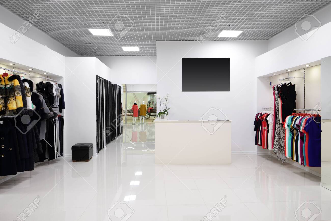 luxury and fashionable brand new interior of cloth store - 151385452