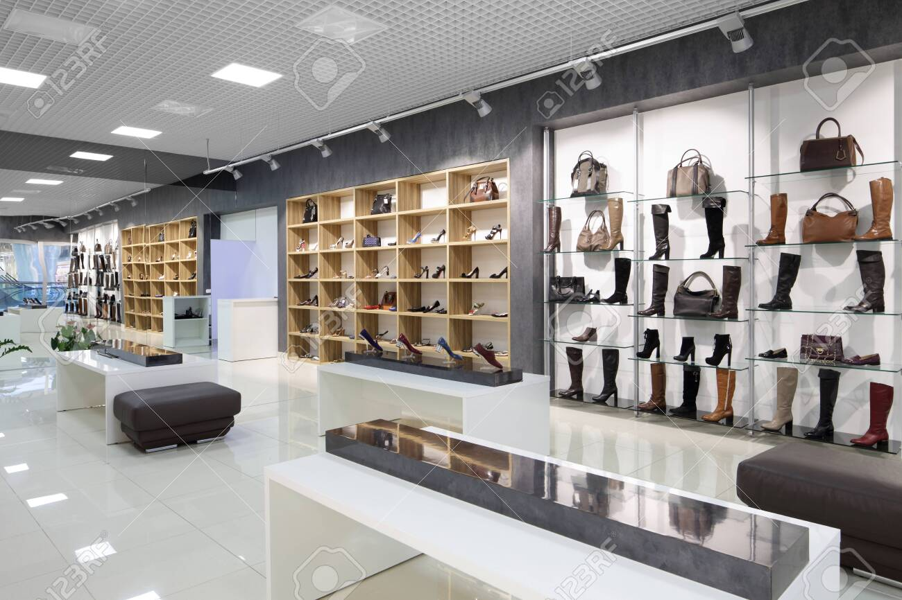 bright and fashionable interior of shoe store in modern mall - 151385347