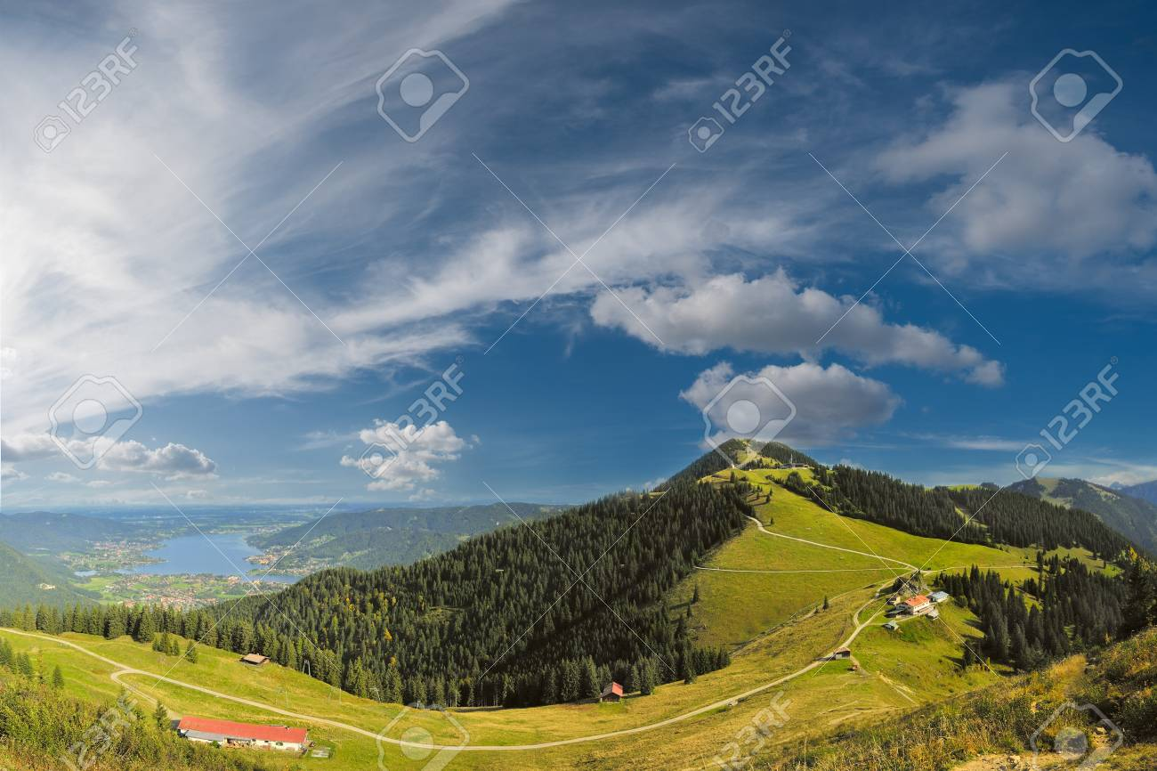 Beautiful panorama Alps mountains with lake in valley and clouds on background Stock Photo - 13826516