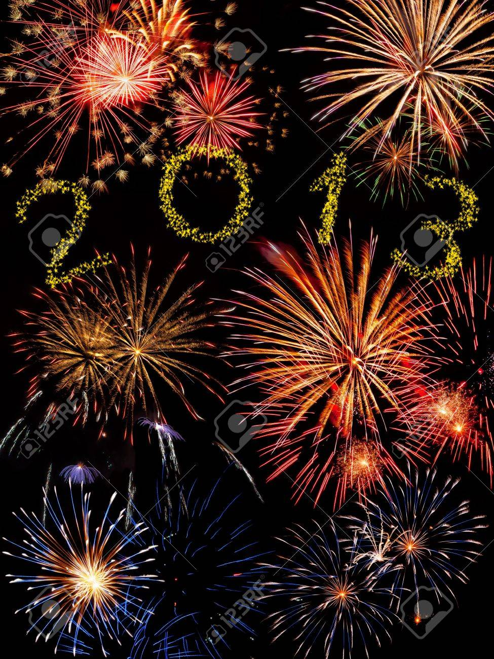 Beautiful colorful 2013 new year fireworks on the black sky background Stock Photo - 15174030
