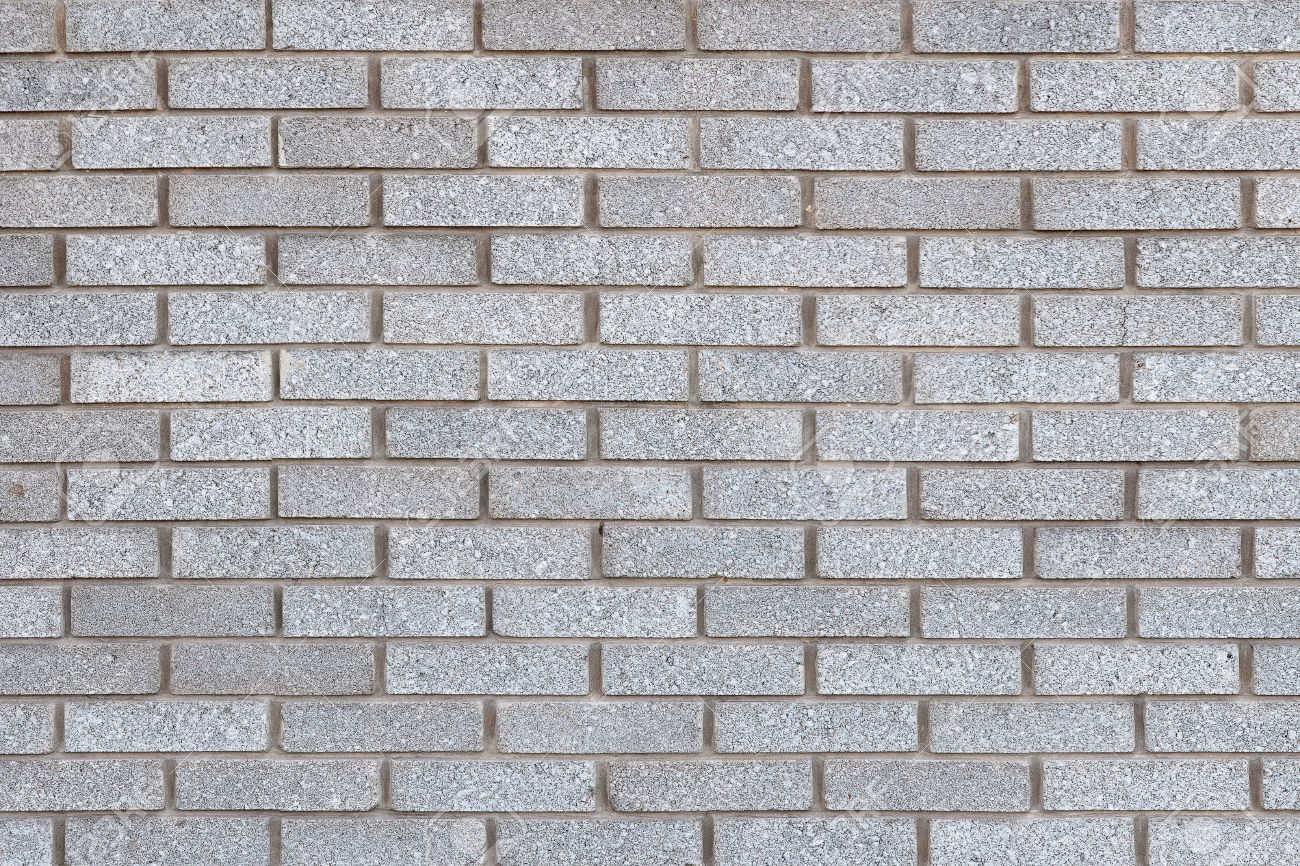 Background Of Grey Brick Wall Texture For Design Stock Photo