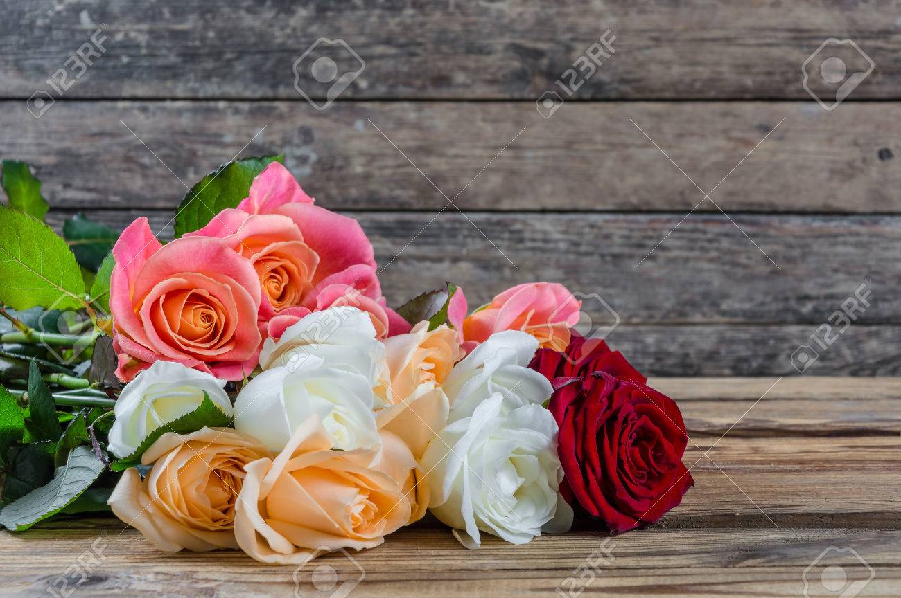 Lovely Rose Flowers On Wooden Table Rustic Design Stock Photo