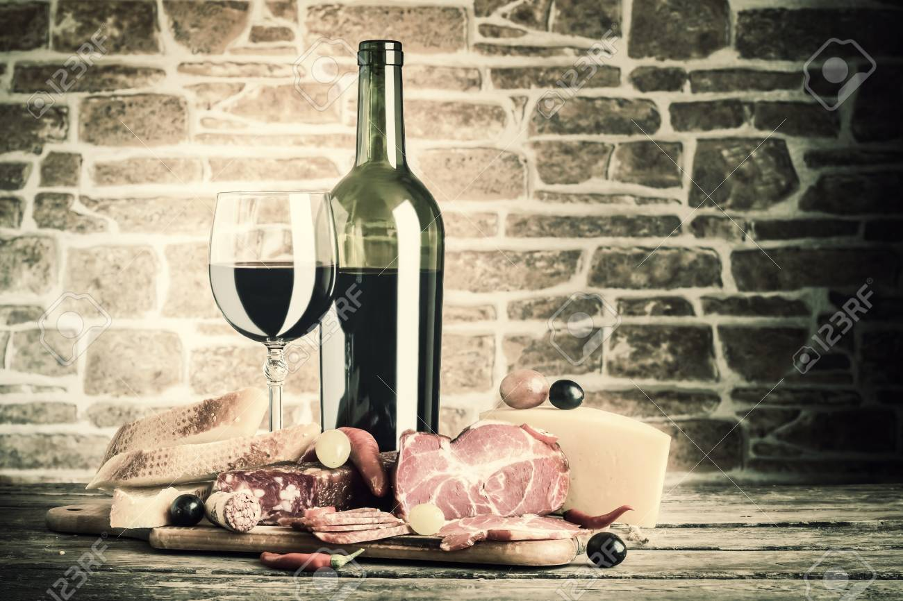 Wine Cheese And Meat On A Wooden Rustic Table Vintage Food Stock