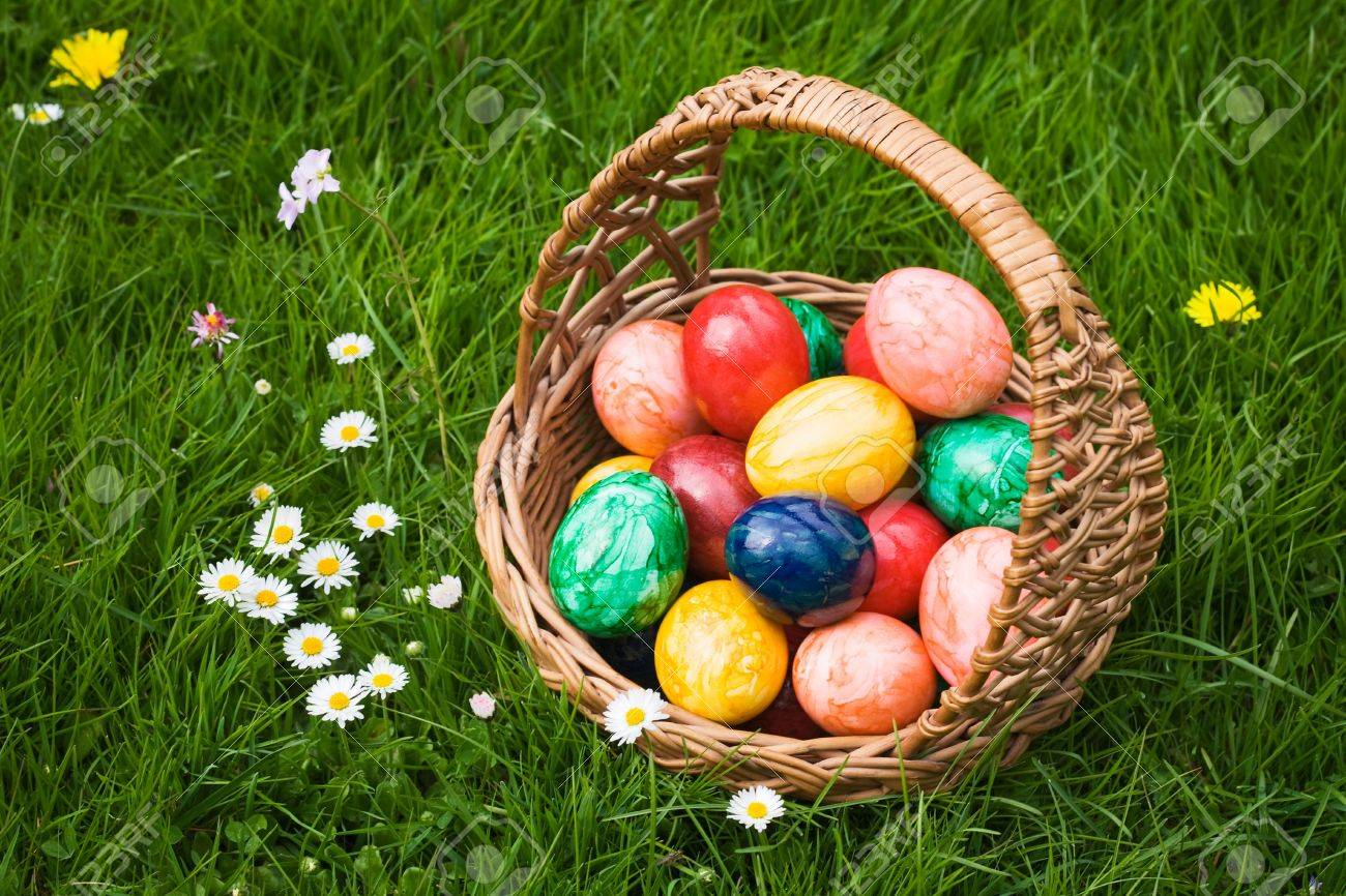 Basket full of Easter eggs in grass Stock Photo - 9422127