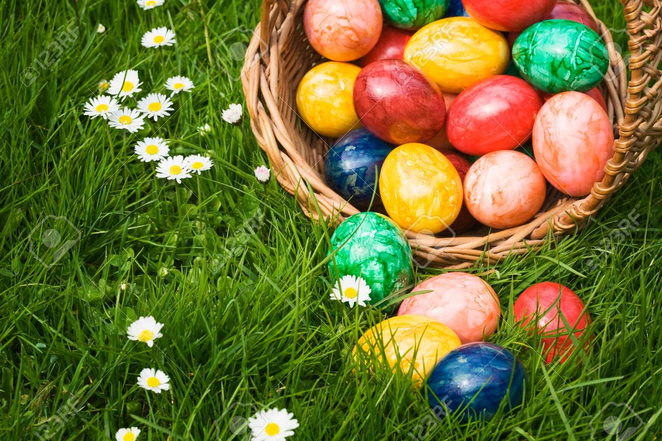 Basket full of Easter eggs in grass Stock Photo - 9465346