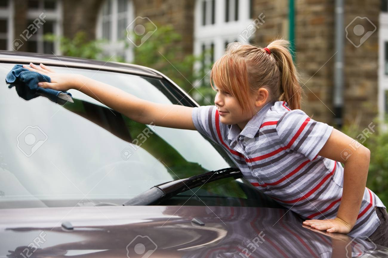 Portrait of young girl washing car Stock Photo - 9661468