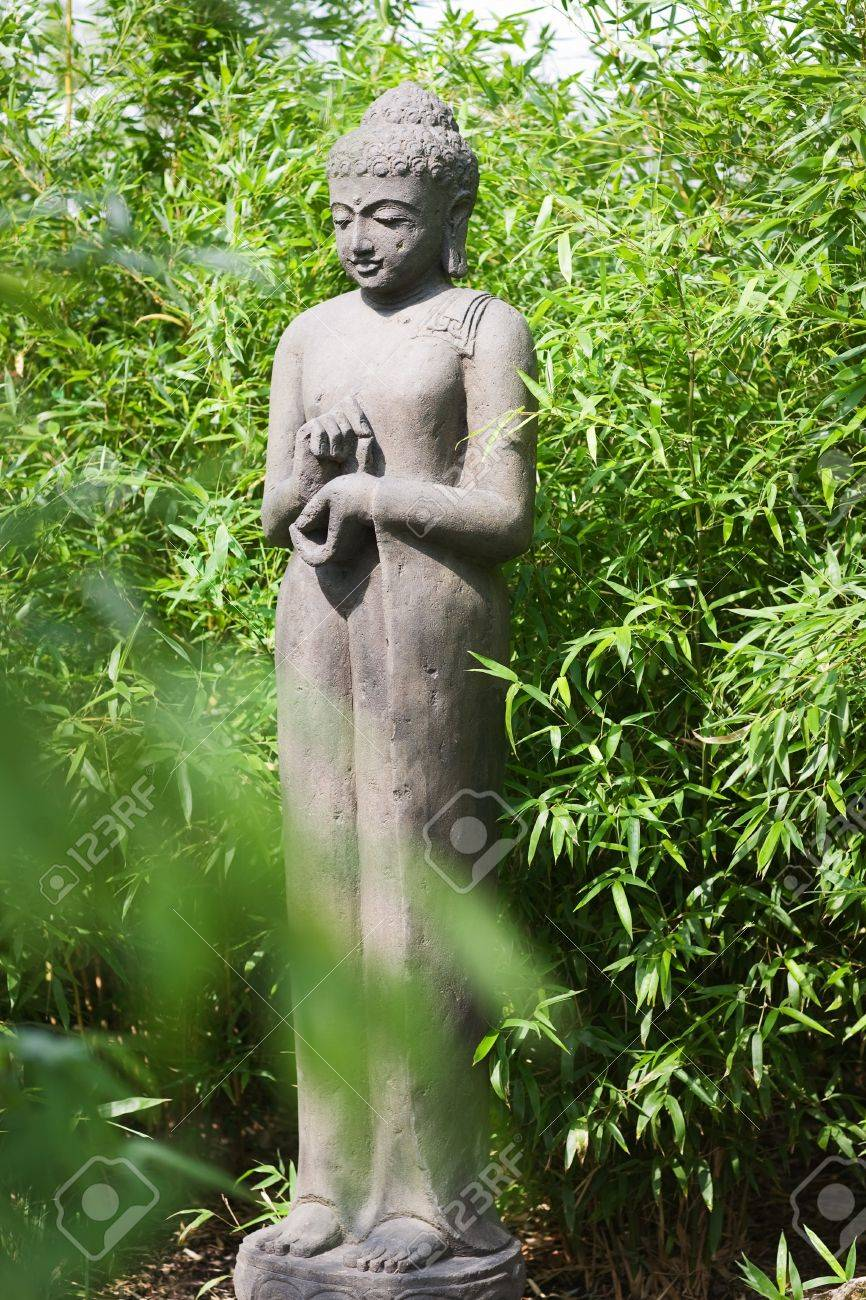 Concrete Buddha Statue In Bamboo Garden Stock Photo Picture And