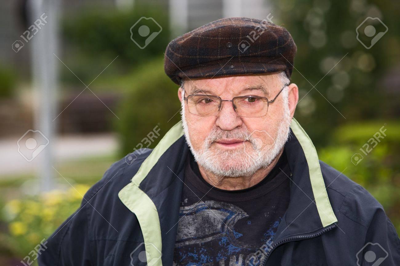 Portrait of senior man wearing flat cap Stock Photo - 9917312 43513af402c
