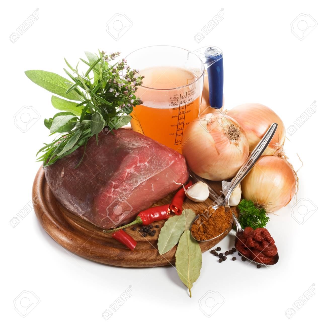 Meat and ingredients for goulash on chopping board, close-up, white background Stock Photo - 15589608