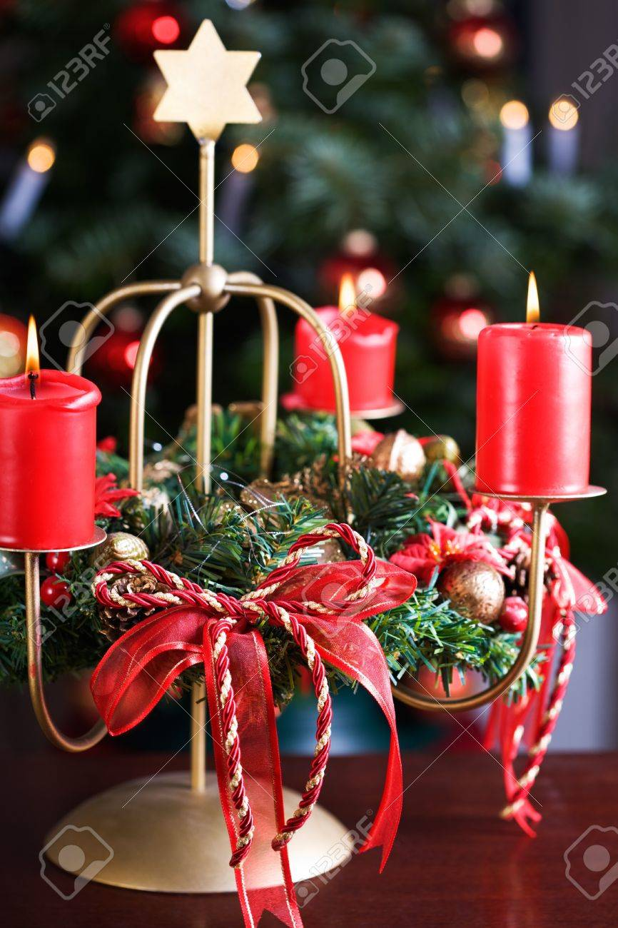 Advent wreath with burning red candles, Christmas tree on background Stock Photo - 15657491