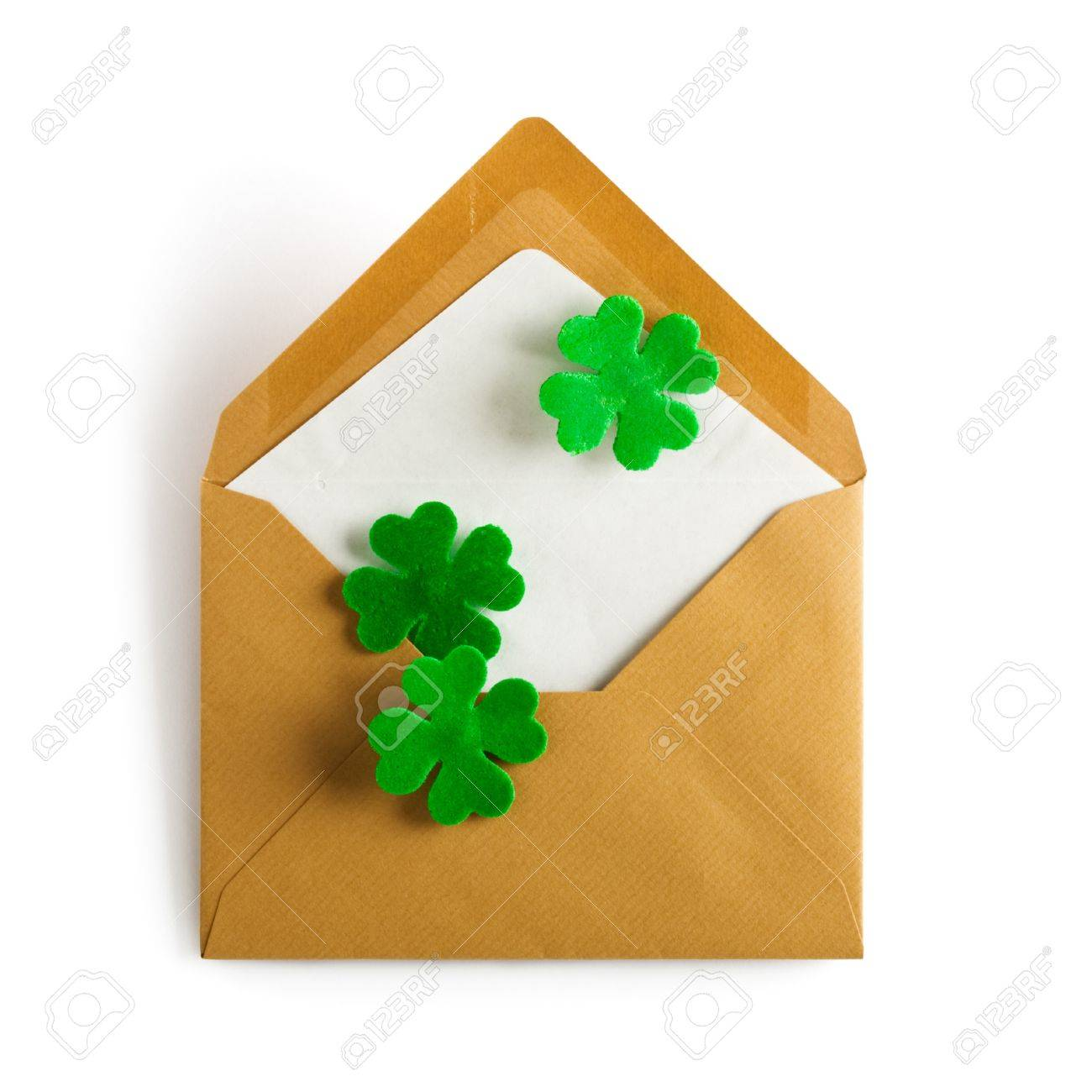 Open brown envelope with four leaf clover for Patricks Day clipping path included Stock Photo - 17077452