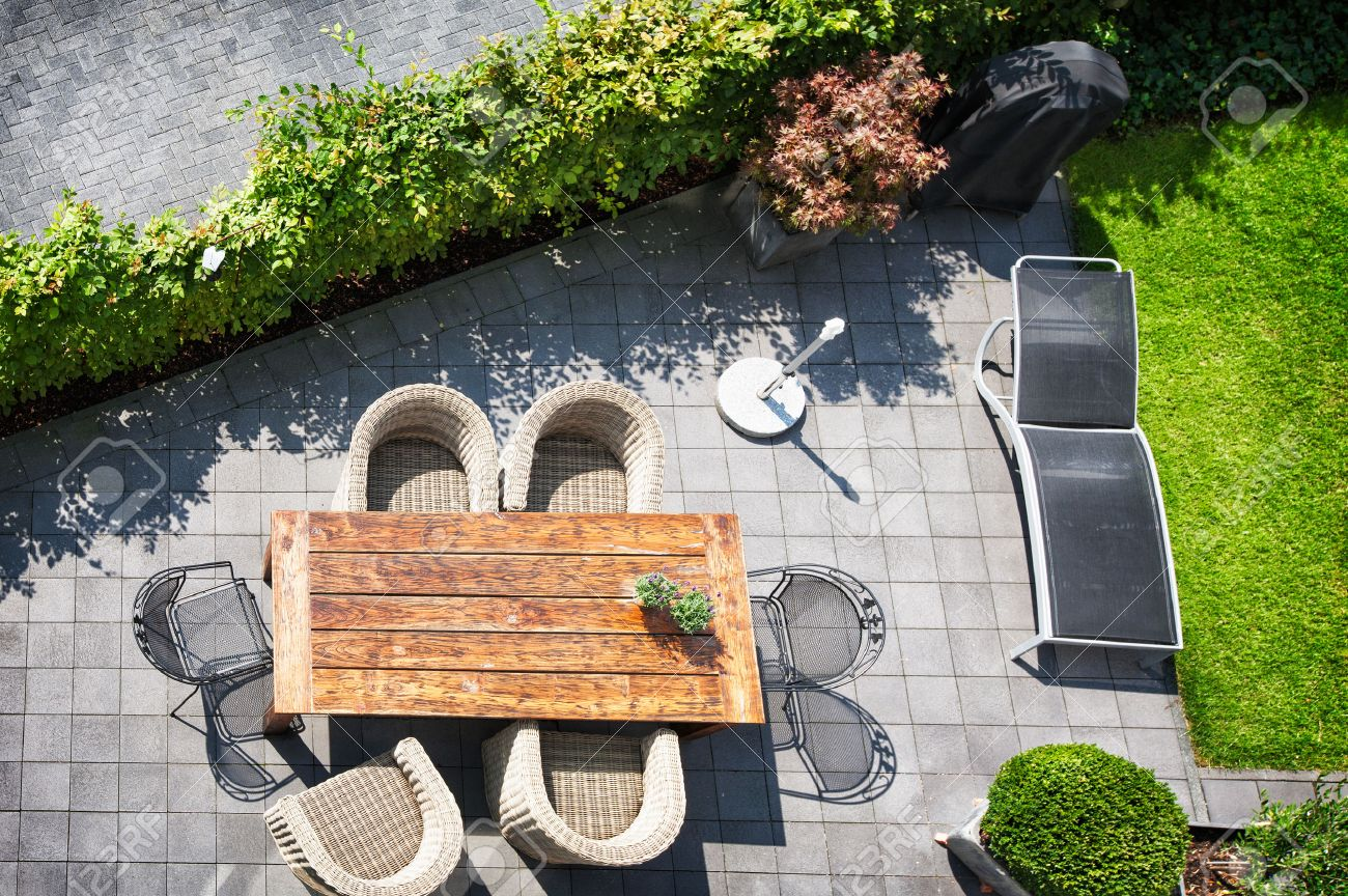 garden furniture sunny patio with table and chairs high angle view