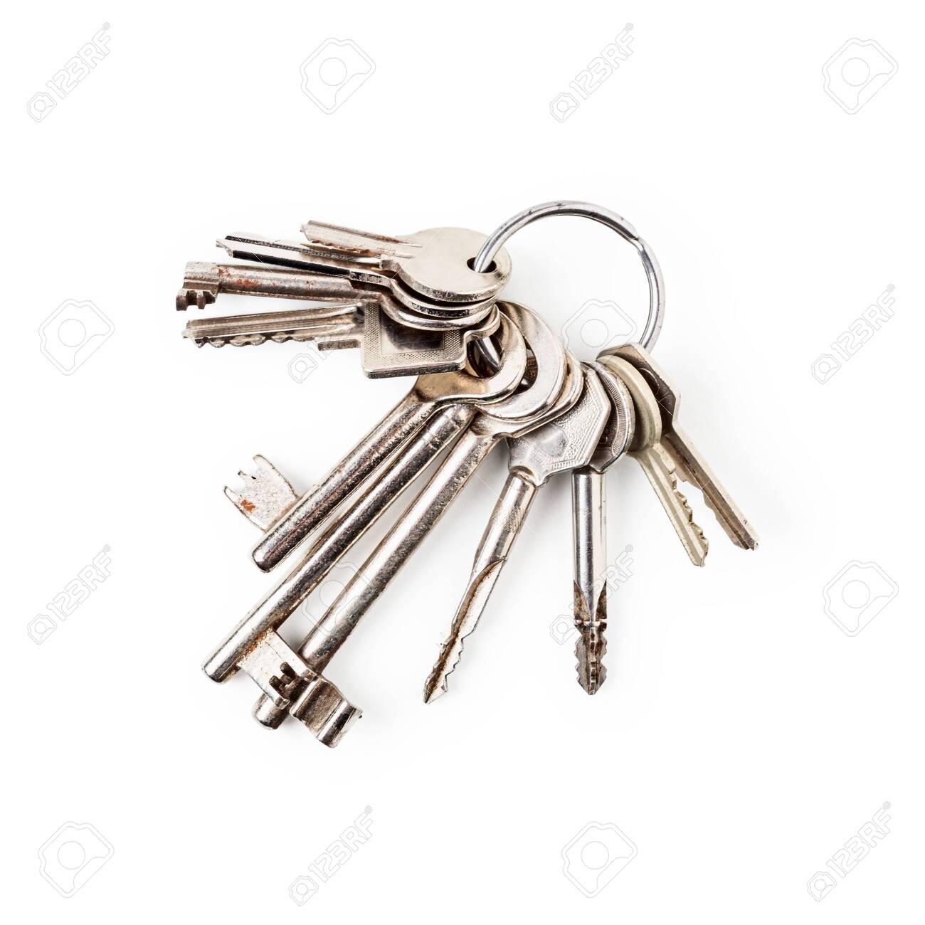 Keys on key ring arrangement isolated on white background - 139473946