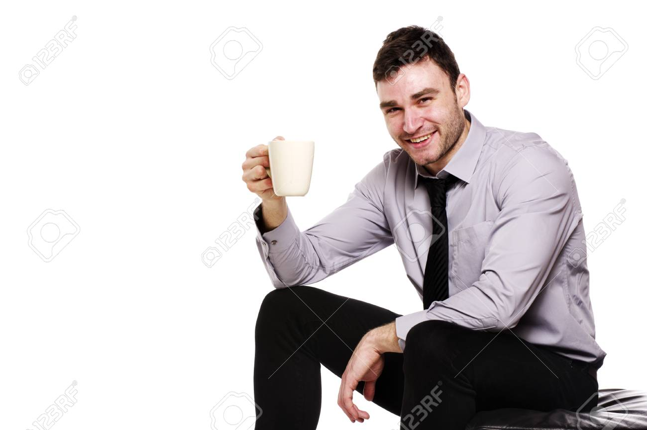 Handsome business man sat isolated on a white background holding up a mug of coffee Stock Photo - 18495233