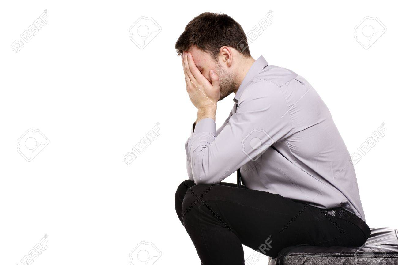 Business man upset sat with his head in his hands isolated on a white background Stock Photo - 18495224