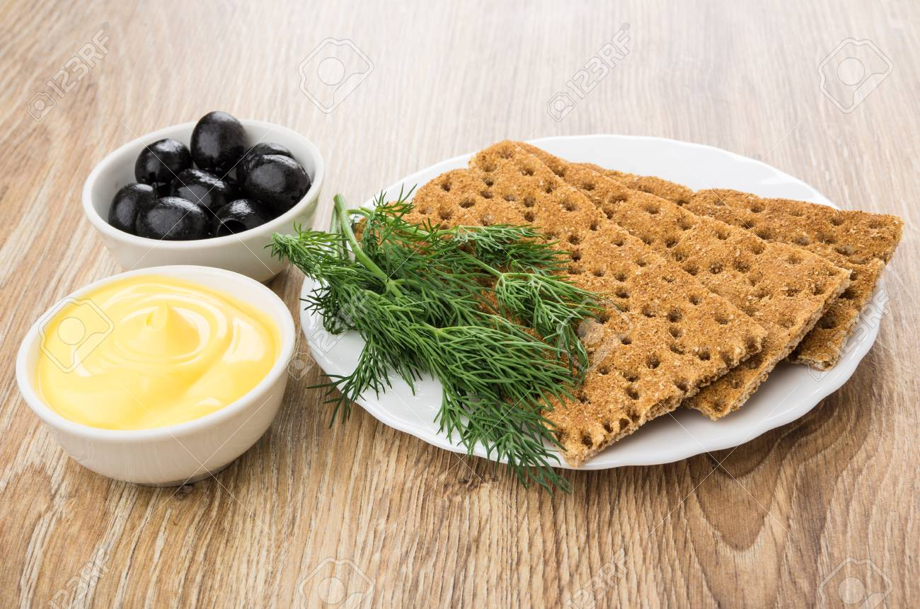 Crispbread And Dill In Plate Bowl With Mayonnaise And Black Stock Photo Picture And Royalty Free Image Image 76233920