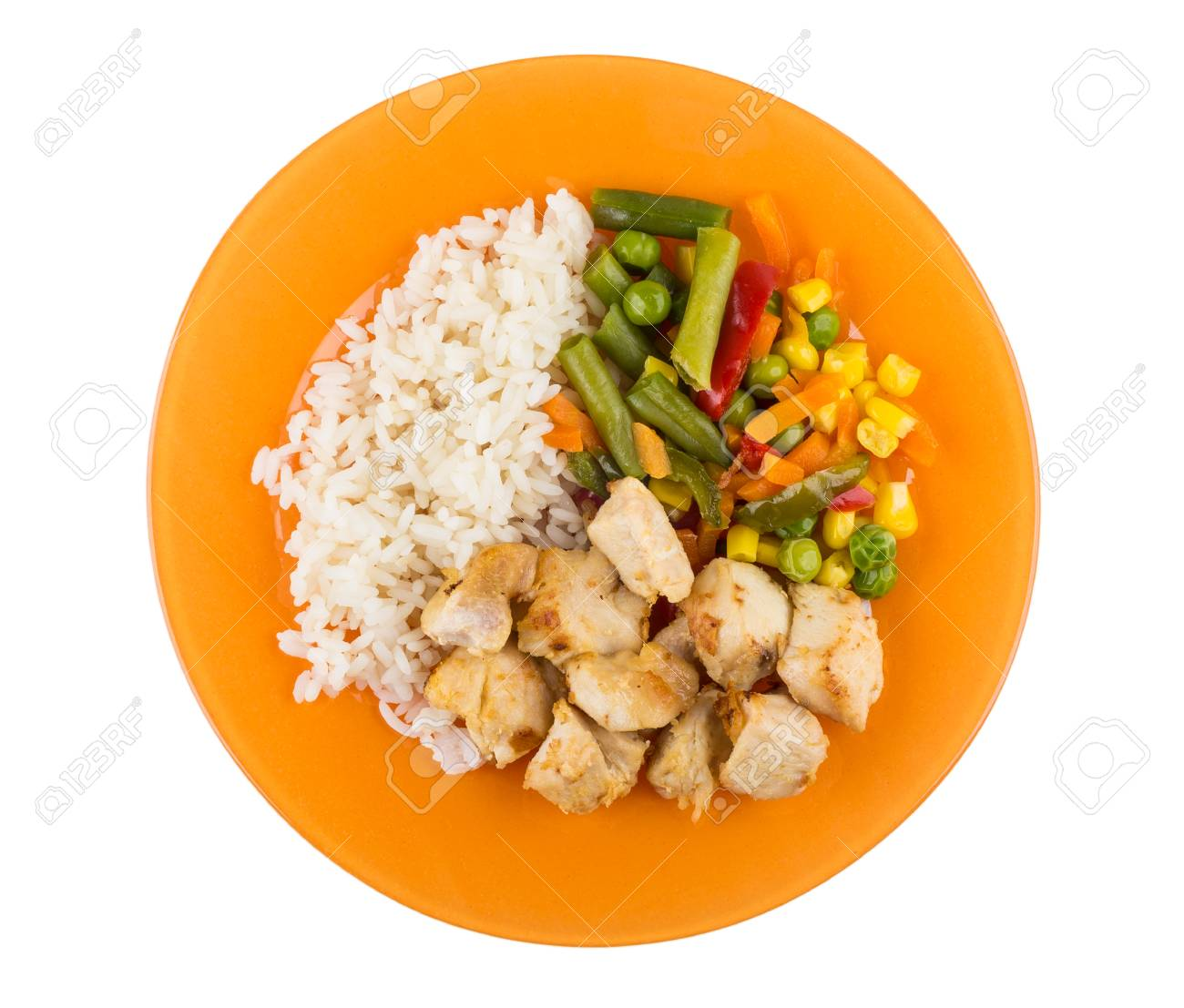 Fried Chicken Meat With Rice And Vegetable Mix On Orange Plate