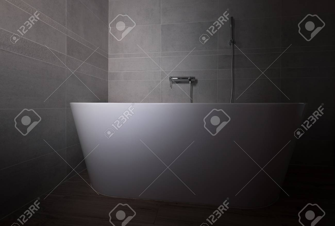 Grey Stone Tiled Modern Bathroom With A White Bathtub Low Light ...