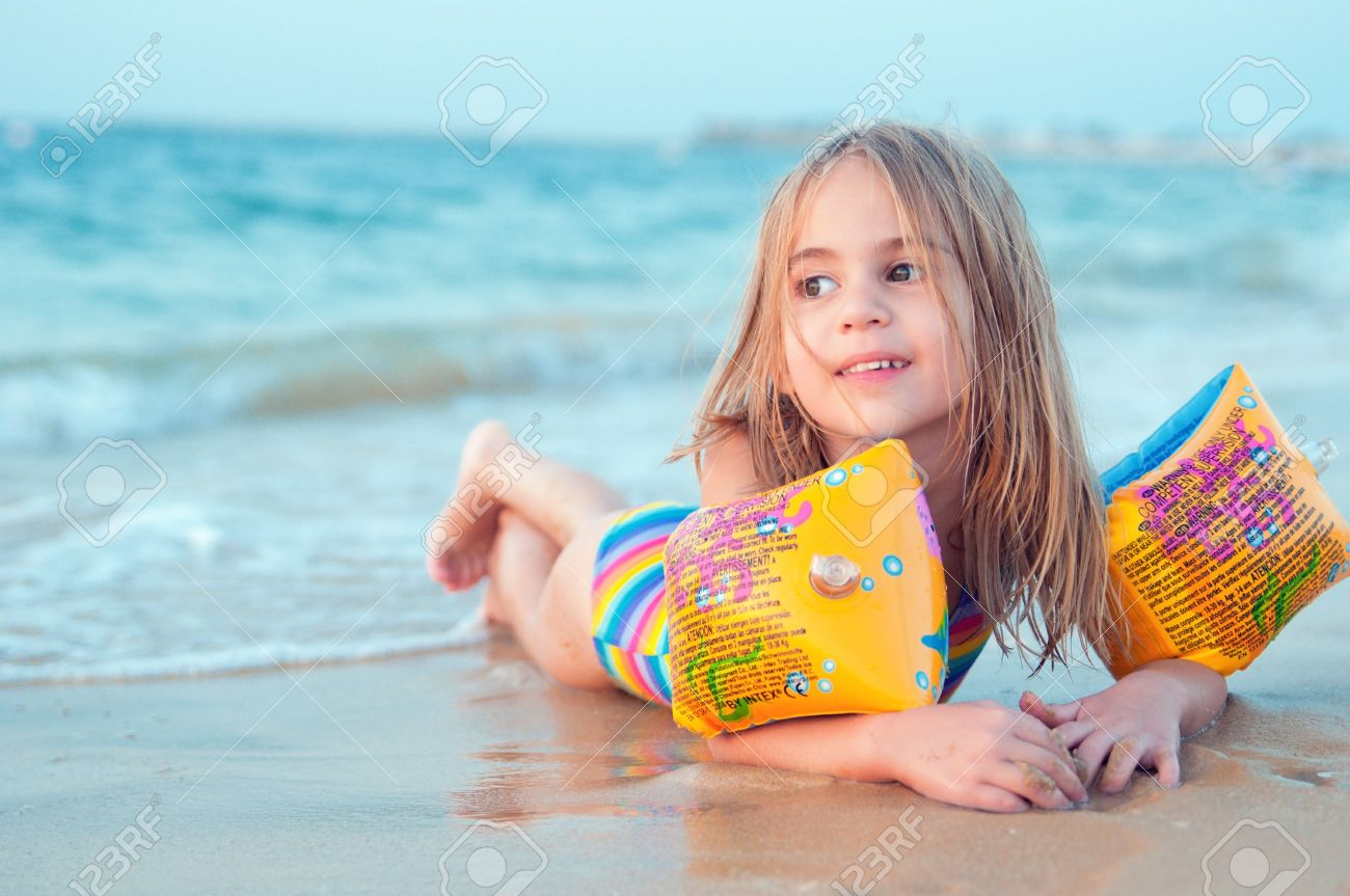 sea vacation happiness happy cute little girl on beach stock photo