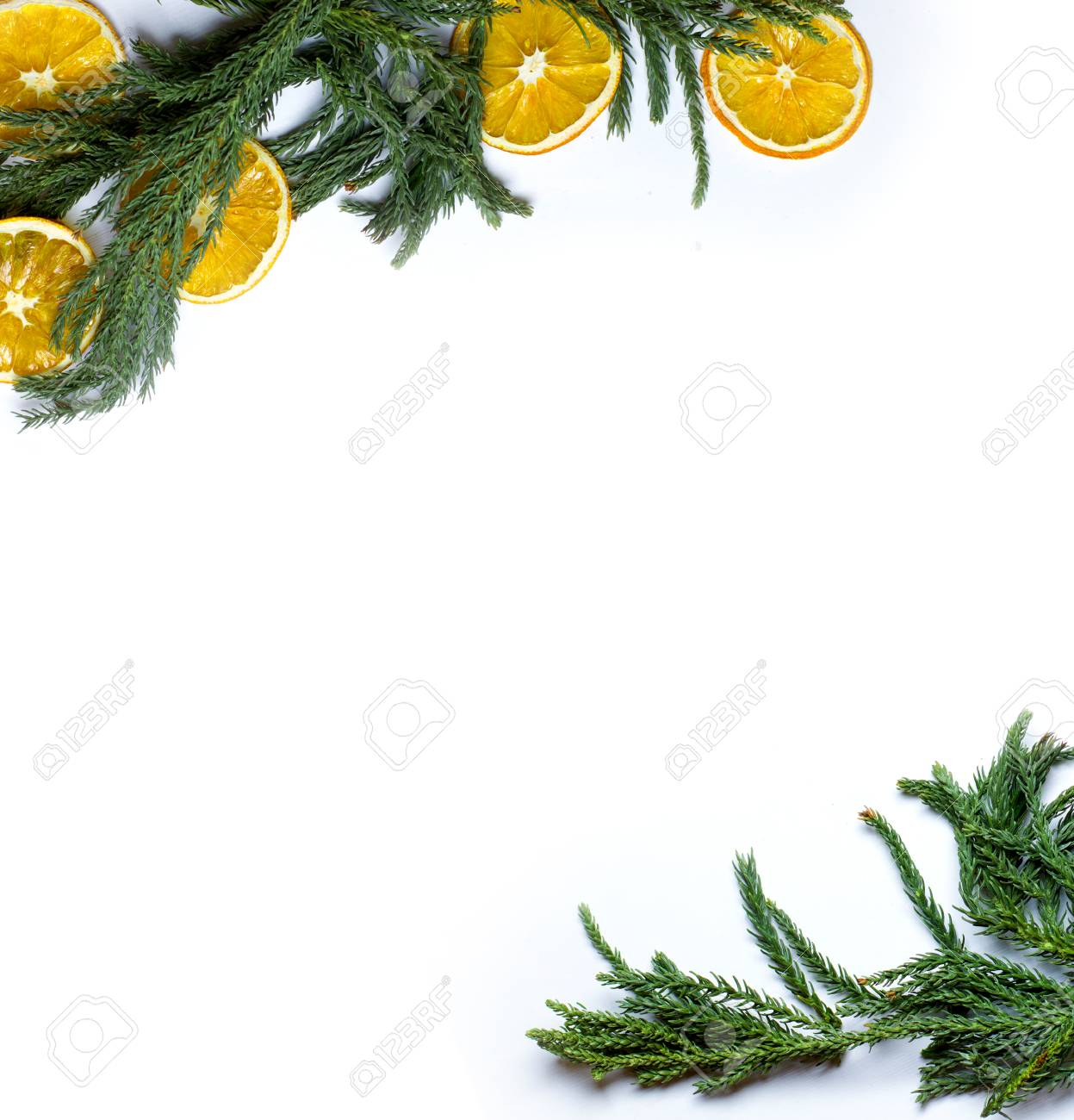christmas diagonal top and bottom corners border frame of fir tree branch dry oranges fruit