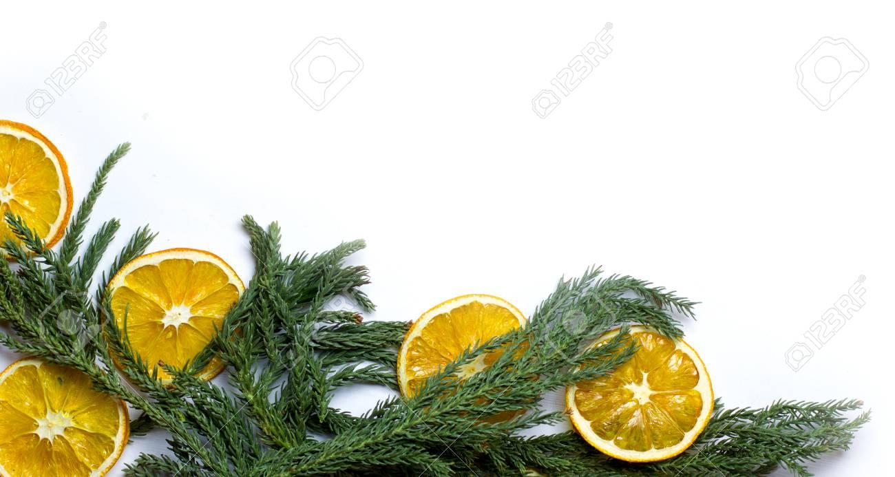 christmas bottom corner border frame of fir tree branch golden pine cones dry oranges