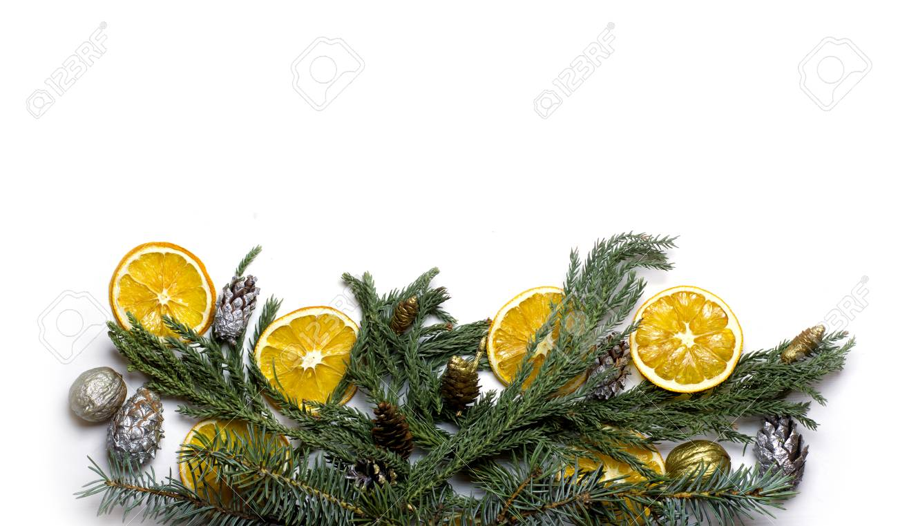 christmas bottom border frame of fir tree branch golden pine cones dry oranges fruit