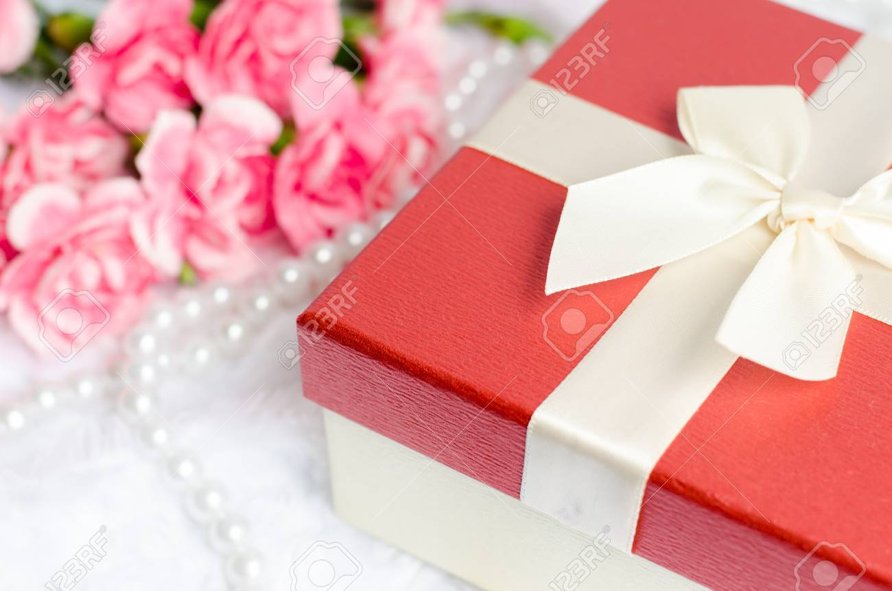 Close Up Of Gift Box With Pearl Necklace And Pink Carnation Flower ...