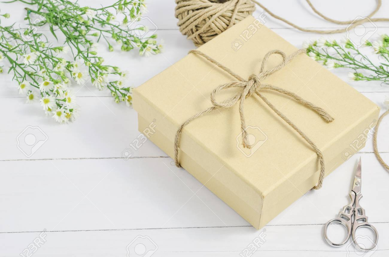 Brown Gift Box With Recycle Ribbon Bow On Wooden Background With ...