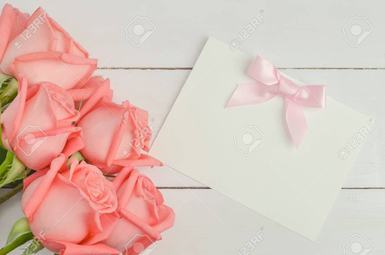 Blank greeting card with pink ribbon bow and pink rose flowers blank greeting card with pink ribbon bow and pink rose flowers on white wooden background with mightylinksfo