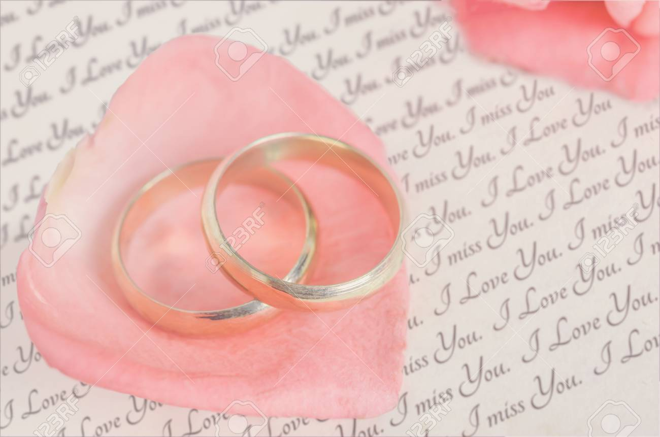 Golden Rings On Pink Rose Petal With Love Message And Pink Rose ...