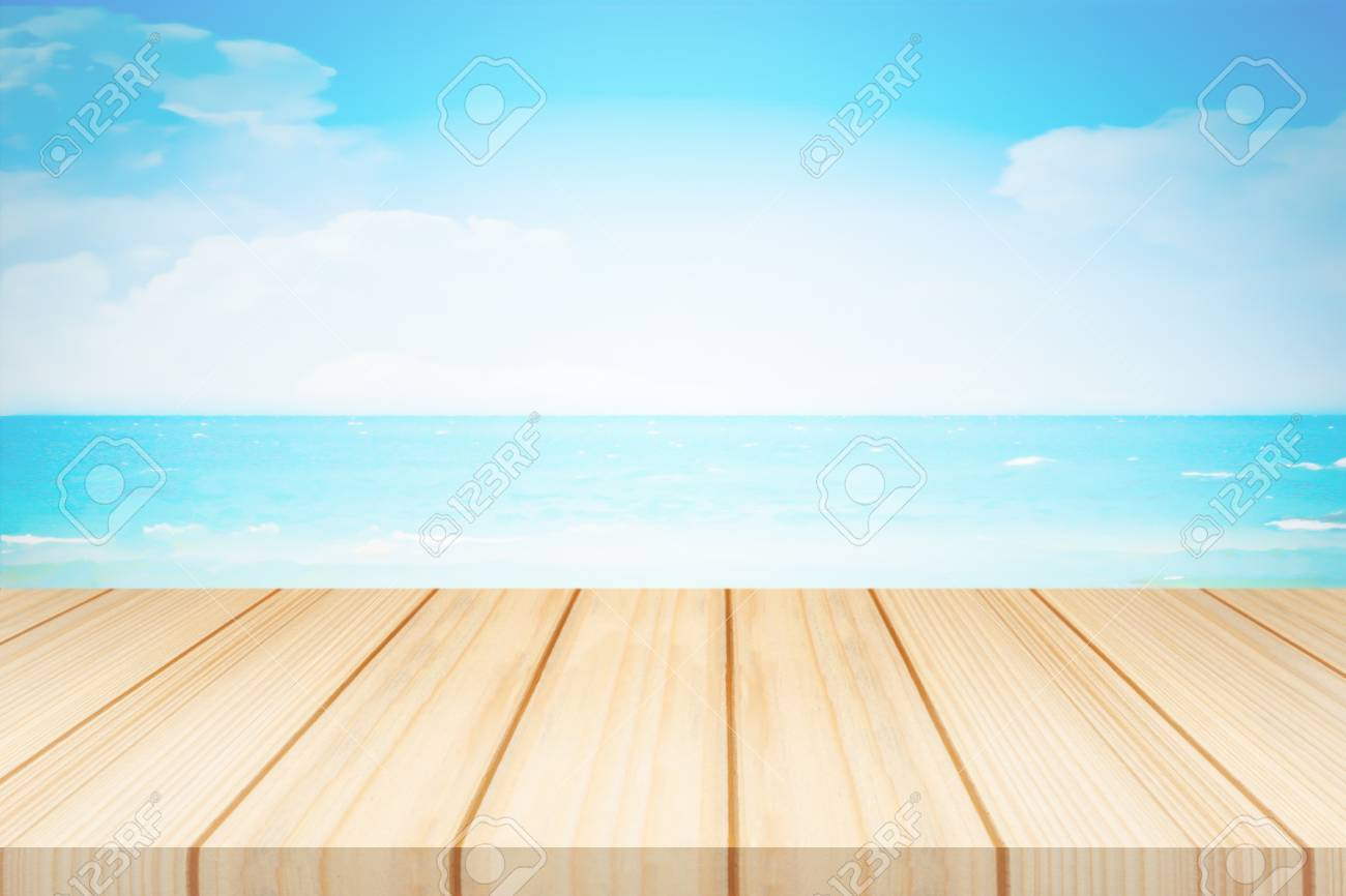 Beige color of wooden table with blue sky and sea background Stock Photo - 92404552