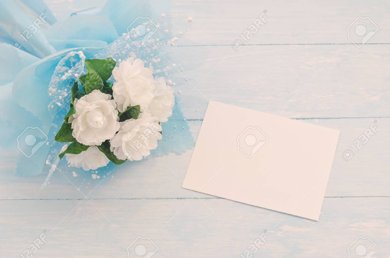 Blank white greeting card paper and beautiful jasmine flower bouquet blank white greeting card paper and beautiful jasmine flower bouquet with blue ribbon bow on white izmirmasajfo Image collections