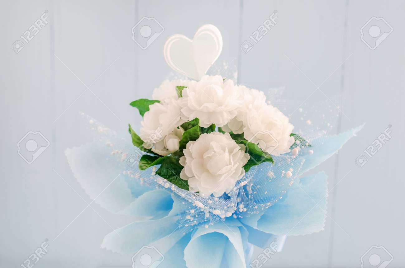 Artificial Jasmine Flower Bouquet With Blue Ribbon Bow On White ...