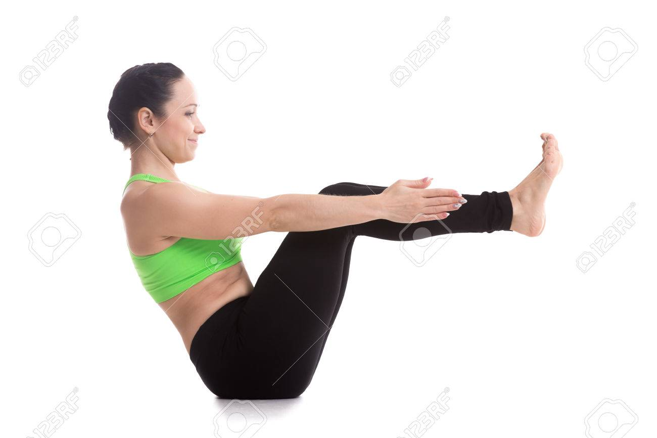 Smiling Sporty Beautiful Girl Practices Yoga Sitting In Boat Pose Navasana Strengthens Abdomen