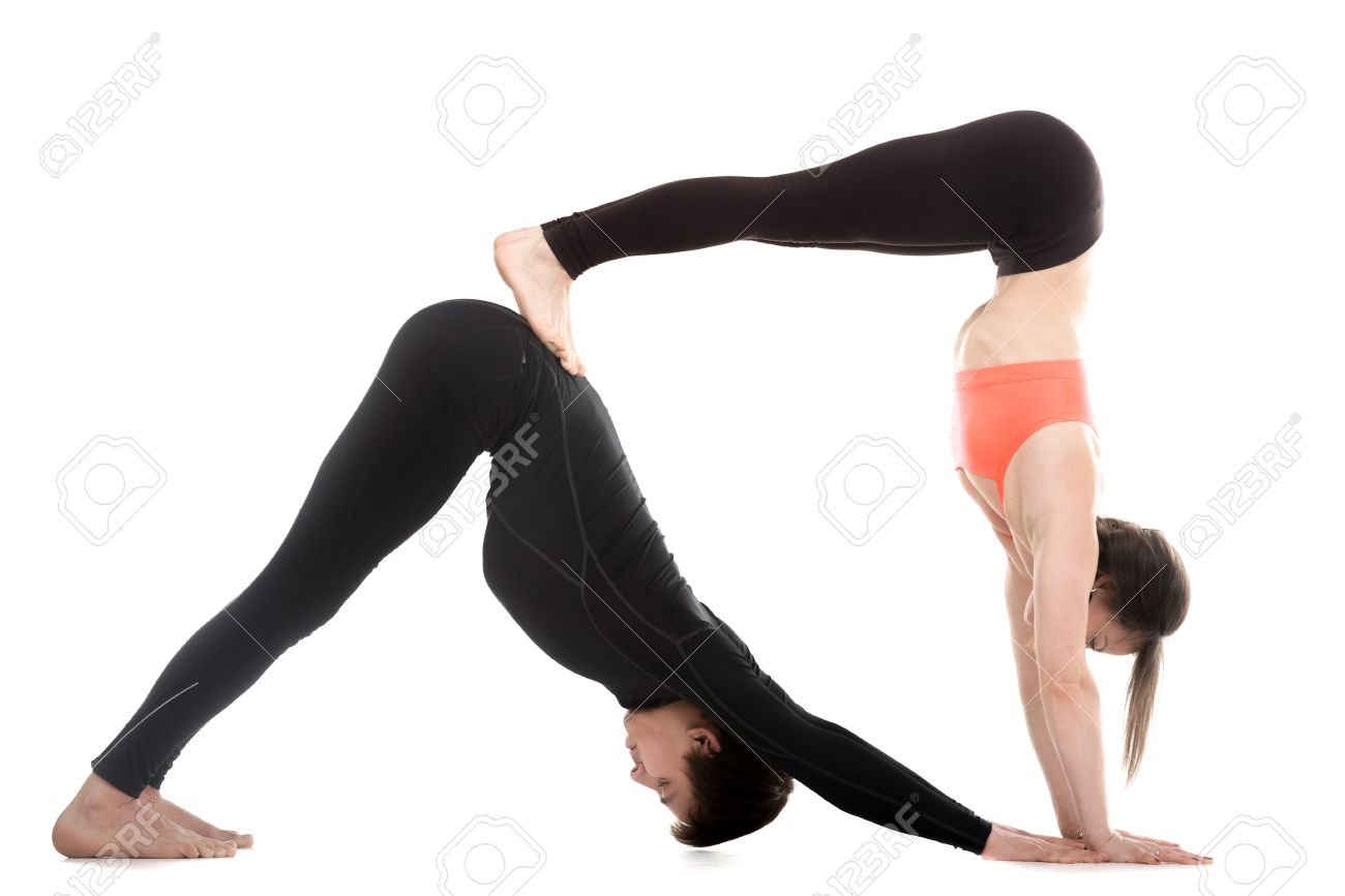 Two Sporty People On White Background Doing Acroyoga Yoga With