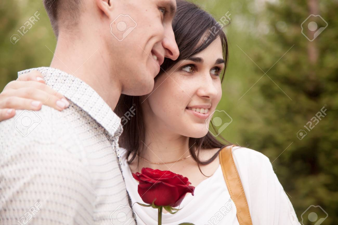 Couple Of Lovers Dating In Park Smiling Young Woman Holding Stock