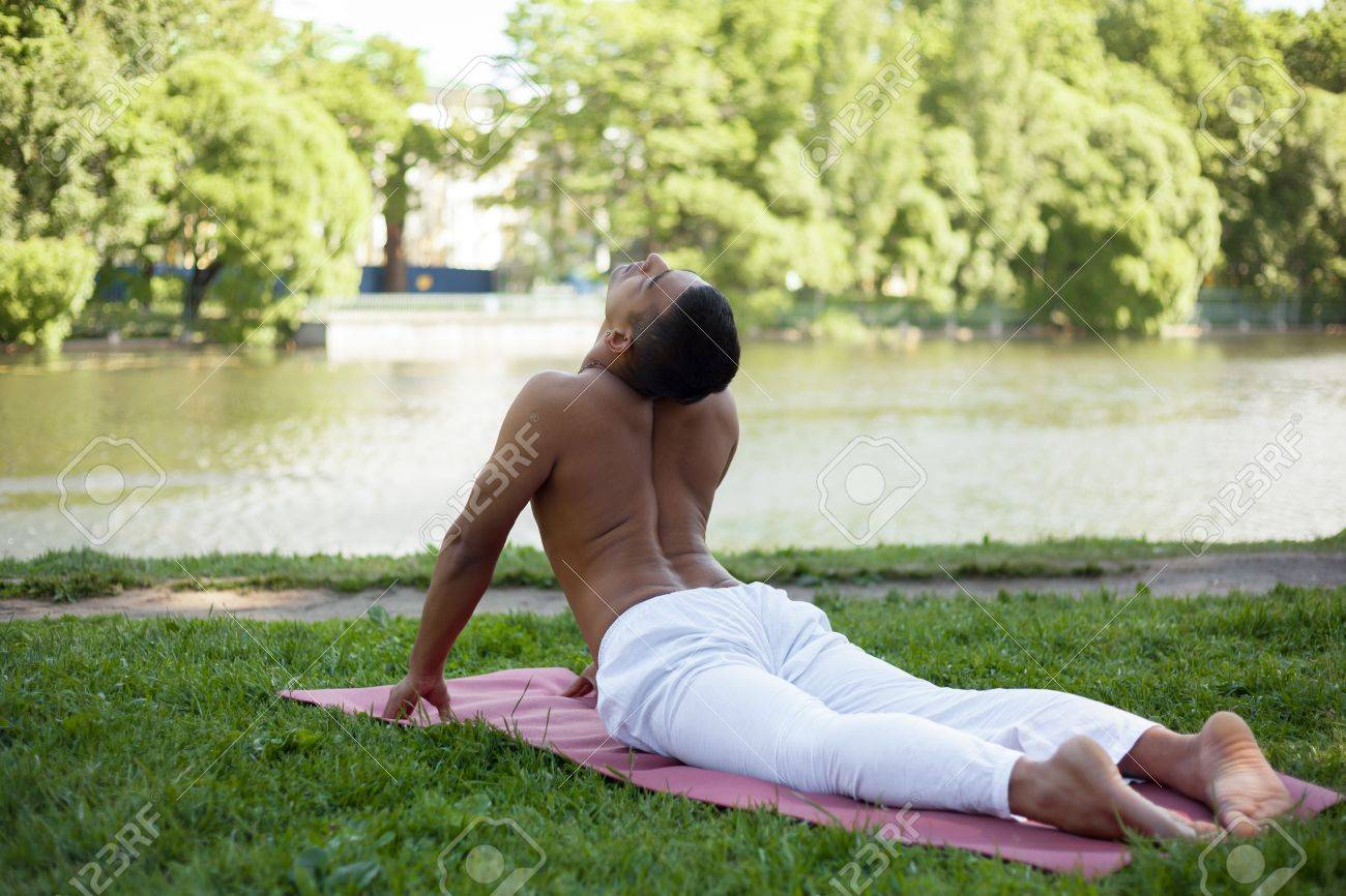 Indian Young Man In White Linen Clothes Practicing Yoga Fitness Stock Photo Picture And Royalty Free Image Image 42306387