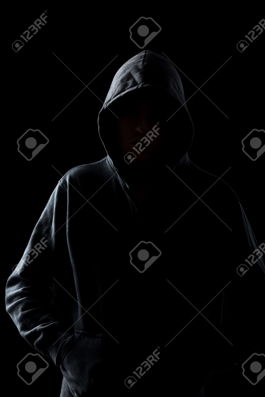Silhouette Of Faceless Guy In Hoodie In The Darkness Concepts Stock Photo Picture And Royalty Free Image Image 46591460 [ 1300 x 866 Pixel ]