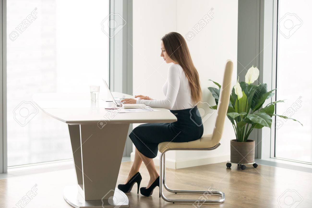 office furniture women. Side View Portrait Of Young Woman In A Formal Wear Working At The Modern Office Desk Furniture Women O