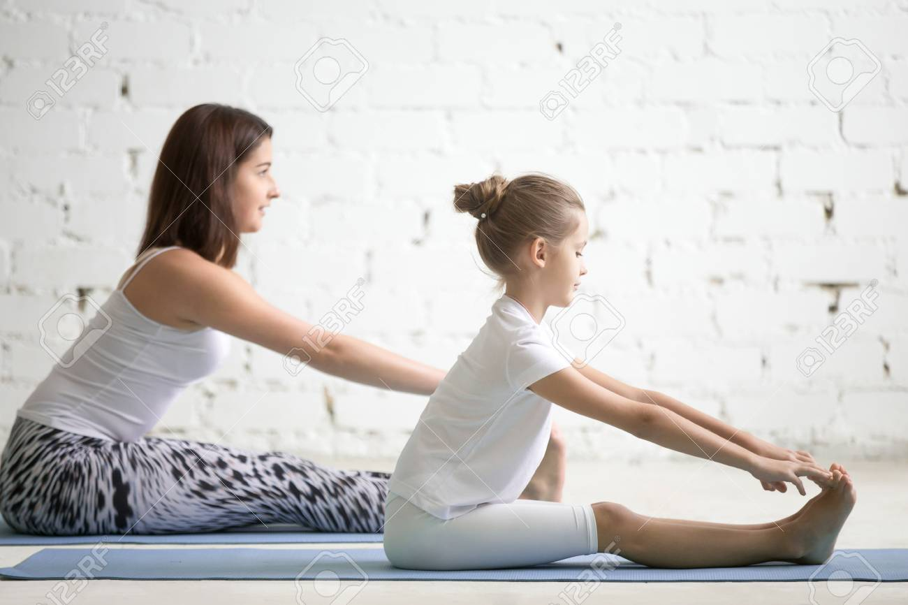 Kids Yoga Female Teacher Training A Girl Child Two People Practicing Stock Photo Picture And Royalty Free Image Image 90771703