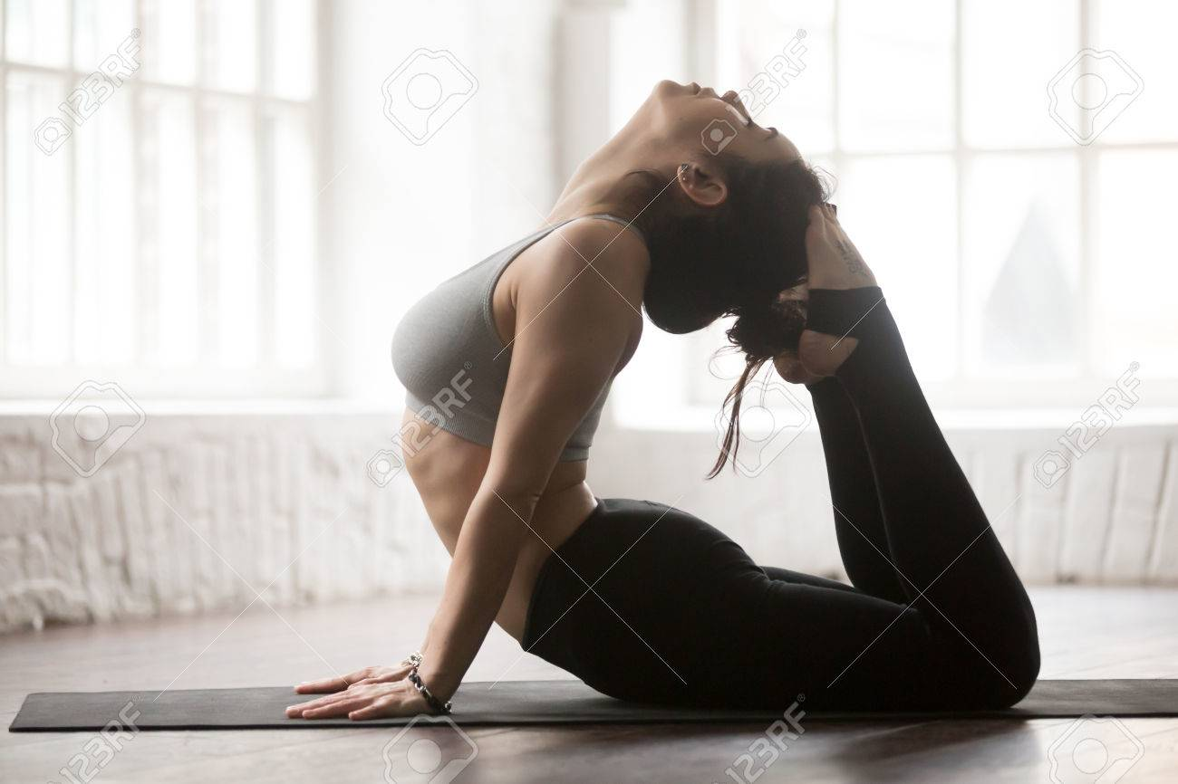 Young Yogi Woman Practicing Yoga Concept Doing King Cobra Exercise