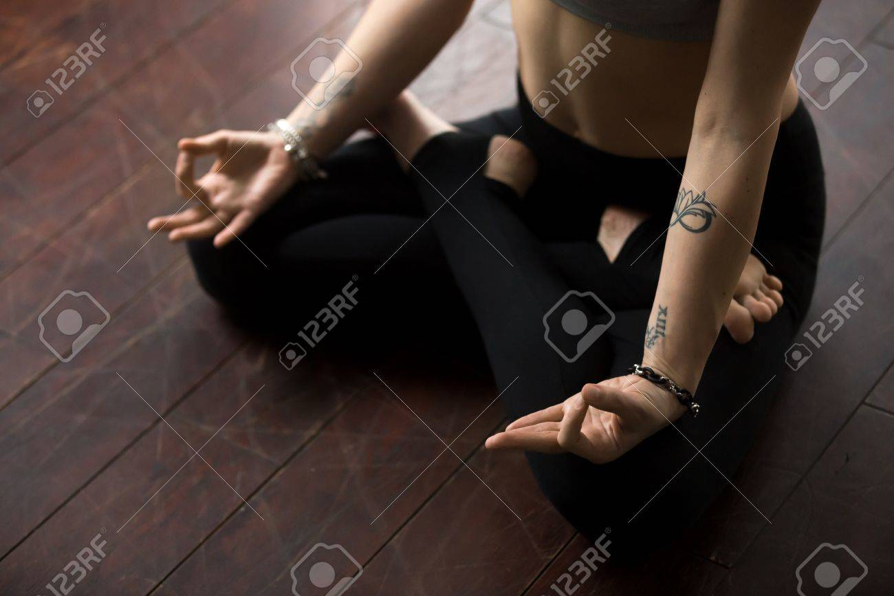 Young Yogi Woman With Tattoo Practicing Yoga Sitting On Floor Stock Photo Picture And Royalty Free Image Image 75178806