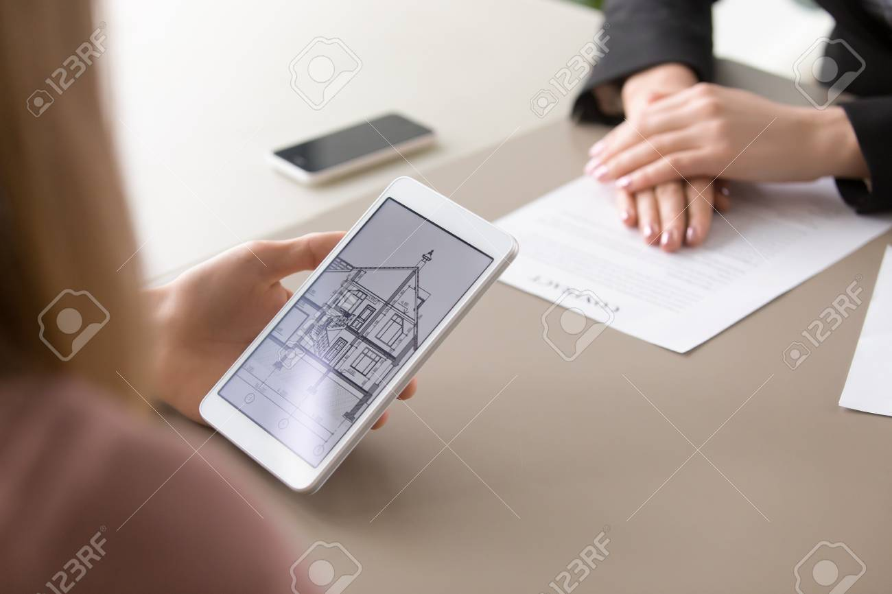Close Up View Of Architectural House Plan On Tablet Screen And