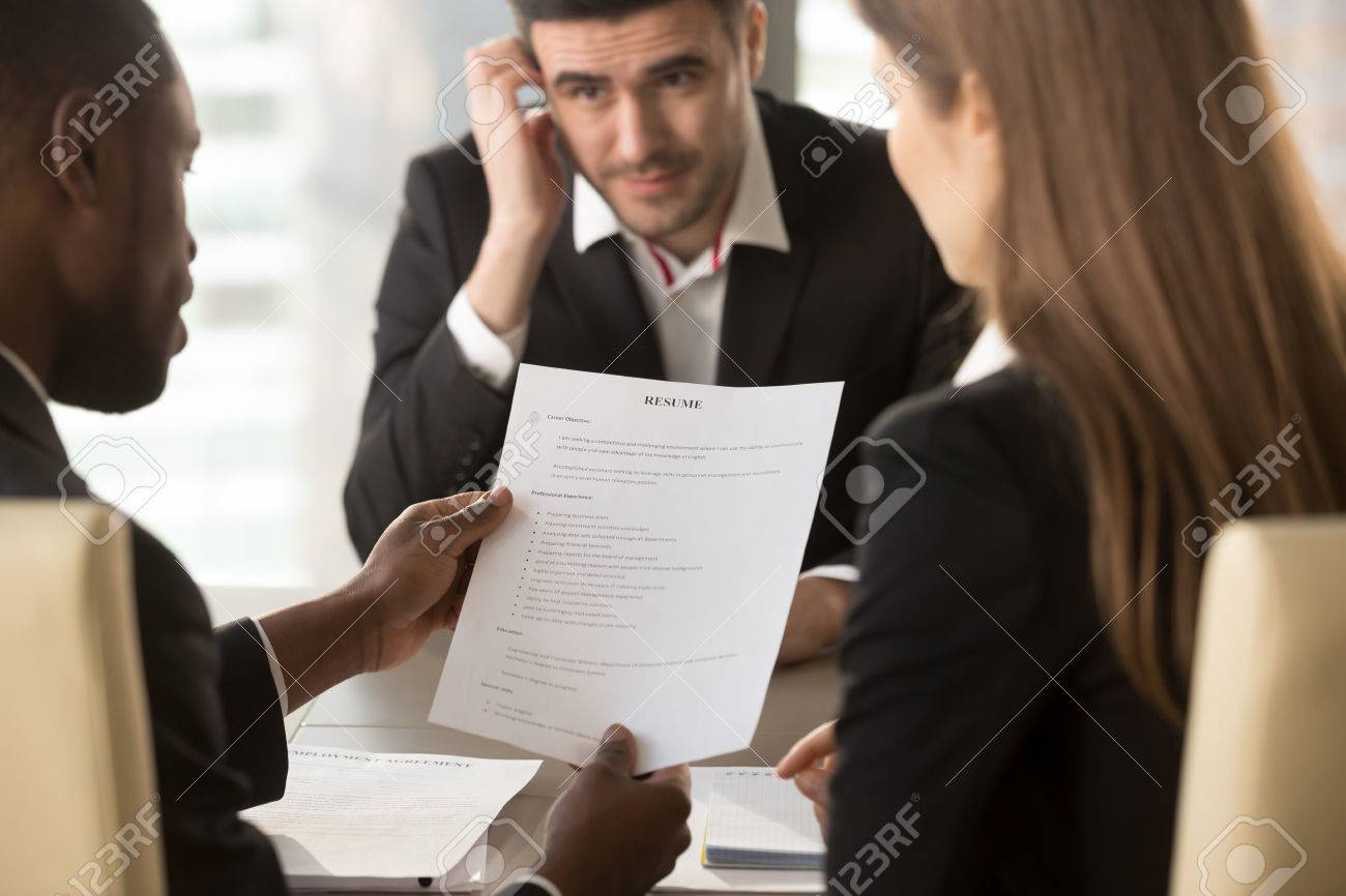 Employers or recruiters holding reviewing bad poor cv of unemployed worried nervous applicant waiting for result, employment and recruitment concept, rejected job application, failed interview, close up - 80154167